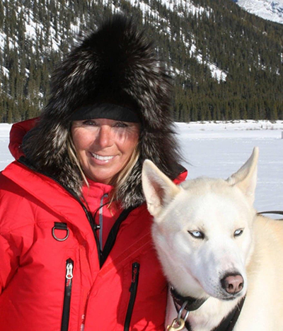 Connie Arsenault, Founder of Snowy Owl Sled Dog Tours, with Pistachio